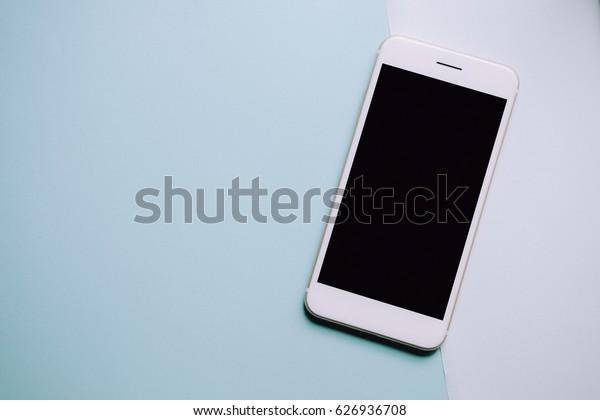Creative flat lay photo with smart phone , minimal style