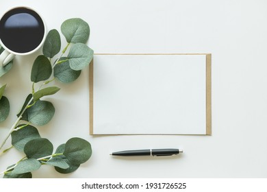Creative flat lay photo of workspace desk. top view office desk with mock up white paper, coffee, pen, plant branches on white background. Workspace concept. Top view, copy space, mockup, flat lay. - Shutterstock ID 1931726525