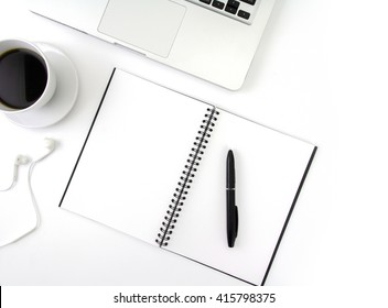 Creative flat lay photo of workspace desk with laptop, earphone, coffee and blank notebook with copy space background, minimal style