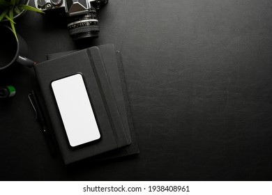 Creative flat lay workspace with smartphone, camera, stationery and copy space, clipping path, top view