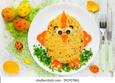 Creative food art idea on Easter meal party for children. Easter salad in the form of cute chicken decorated egg yolk and vegetables