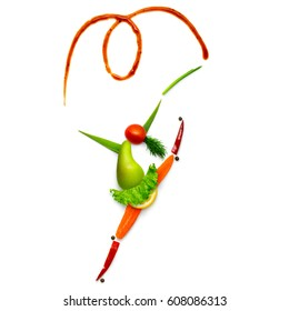 Creative food concept of a gymnast made of vegetables and fruits isolated on white.