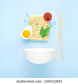 Creative food diet healthy eating concept photo of tasty ramen noodle pasta with vegetables tomato egg greens chopsticks and bowl on blue background.