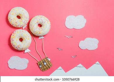 Creative Food Minimalism, Donut in Shape of Aerostat in Pink Sky with Clouds, Mountains, Top View, Copy Space, Travel
