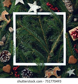Creative frame of Christmas tree branches and decorations with space for text. Top view. Xmas and New year concept