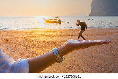 Creative funny shot summer lifestyle couple traveler joy fun vacation beach at sunset, Young man pose on woman's hand, Tourist people enjoy travel Trang Thailand, Tourism destination Asai holiday trip