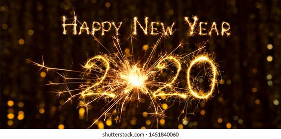 Creative Greeting card Happy New Year 2020. Beautiful Wide Angle holiday web banner or billboard with Golden sparkling text Happy New Year 2020 written sparklers on festive bokeh background.