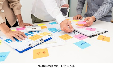 Creative group of business people brainstorming use sticky notes to share idea on table or table in office
