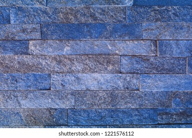 creative grunge blue natural quartzite stone bricks texture for use as background.