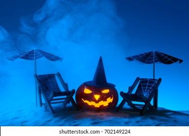 Creative Halloween pumpkins glowing in moonlight on sandy beach with sunbeds and umbrellas