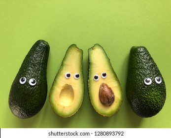 Creative healthy food concept. Avocados with googly eyes, whole and cut in half.  Making  food fun.