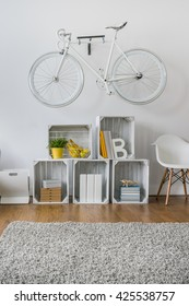 Creative hipster room with fruit wooden crates as modular rack
