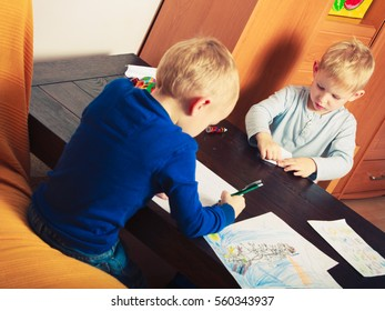 Creative hobby, kids passion concept. Two boys playing together, drawing pictures on paper