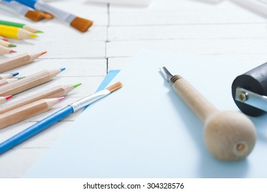 creative hobby tools on white wood