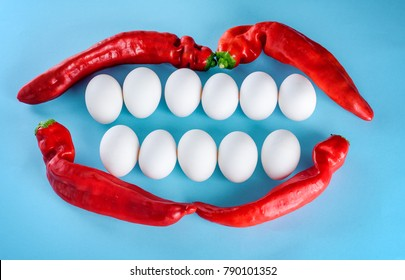 A creative idea for advertising a dental clinic and dentistry.Beautiful smile from white eggs and red pepper. White teeth, happy lifestyle. Healthcare, medical and stomatology concept.