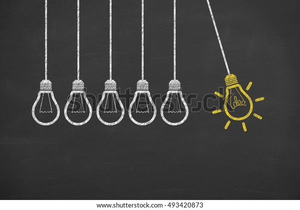 Creative idea. Concept of idea and innovation with light bulb on blackboard