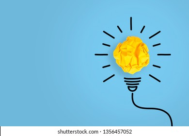 Creative Idea Concepts Light Bulb with Crumpled Paper on Blue Background