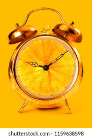Creative idea fresh portion outdoor alarm clock on yellow background. Business concept minimal idea. creative fruit idea to advertise work within an advertising marketing communication