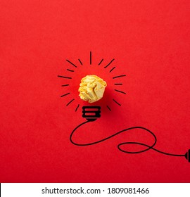 Creative idea, Inspiration, New idea and Innovation concept with Crumpled Paper light bulb on red background.