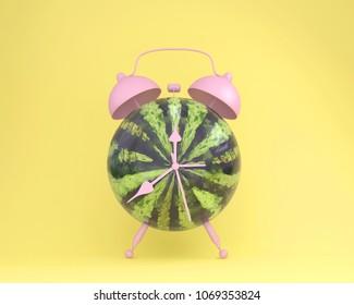 Creative idea layout fresh watermelon alarm clock on pastel yellow background. minimal idea business concept. fruit idea creative to produce work within an advertising marketing communications