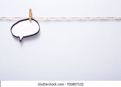 Creative ideas concept. Blank speech bubble hadcrafted on white background, top view, copy space for text