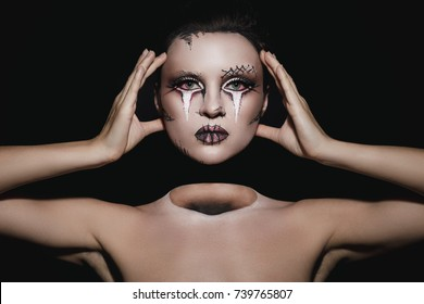 Creative image for Halloween - Dead woman without head. Effect was achieved with work of professional makeup artist.