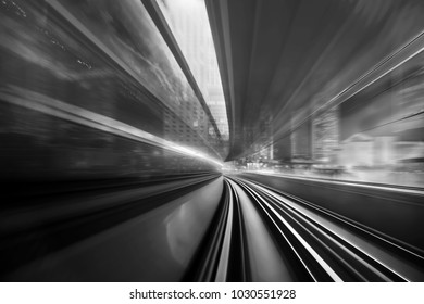 Creative image of moving train on city with black and white tone