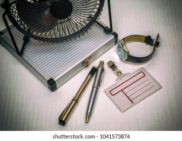 Creative image workplace with office tools office tools blank notebook with pen, glasses and table fan in office desk.