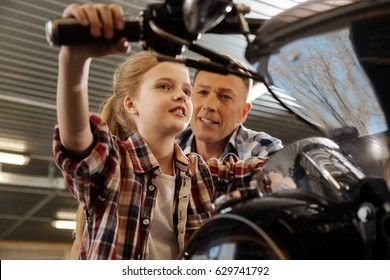 Creative imaginative girl dreaming about a real ride