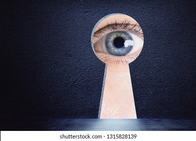 Creative keyhole opening with eye on concrete wall background. Access and vision concept