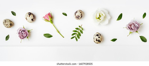 Creative layout floral pattern with quail eggs. Easter minimal concept, anner format.