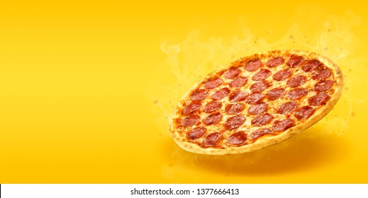 Creative layout of hot delicious pizza with smoke in flying on summer orange background. Pizza pepperoni design mockup flyer or poster for promotions and discounts with copy space. Fast Food concept.