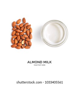 Creative layout made of almond milk and almonds on white background. Flat lay. Food concept.