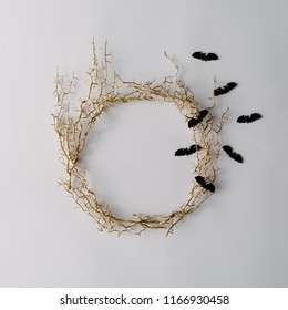Creative layout made of autumn tree branches with bats. Minimal flat lay. Halloween concept.