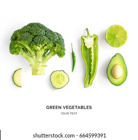 Creative layout made of avocado, lime, broccoli, green pepper, cucumber, chilli pepper and zucchini. Flat lay. Food concept. Green vegetables isolated on white background.