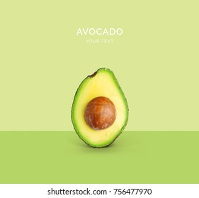 Creative layout made of avocado on the green background. Flat lay. Food concept. Macro  concept.
