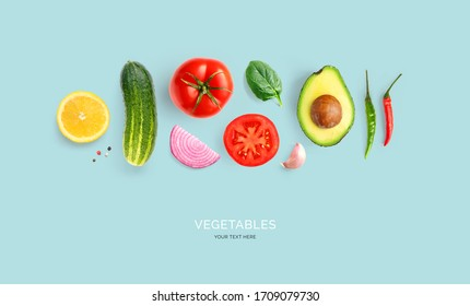 Creative layout made of avocado, onion, tomatoes, chilly pepper, cucumber, garlic and lemon. Flat lay. Food concept.