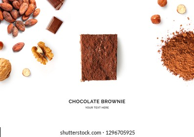 Creative layout made of brownie, walnut, hazelnut, chocolate and cacao powder on the white background. Flat lay. Food concept.