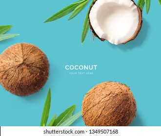 Creative layout made of coconut. Flat lay. Food concept. Macro concept. Blue background.