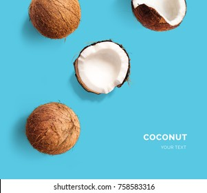 Creative layout made of coconut on blue background. Flat lay. Food concept. Macro  concept.