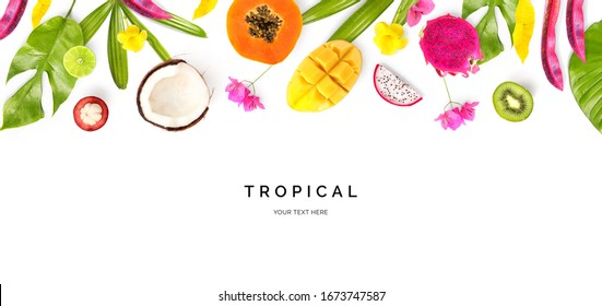 Creative layout made of coconut, papaya, dragonfruit, lime, kiwi, mango, mangosteen and tropical leaves and flowers on the white background. Flat lay. Food concept. Macro  concept.