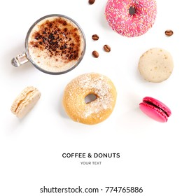 Creative layout made of coffee, coffee beans, macaroons and donuts . Flat lay. Food concept. Macro  concept.