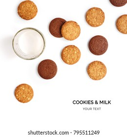 Creative layout made of cookies and glass of milk. Flat lay. Food concept. Cookies and glass of milk on the white background.