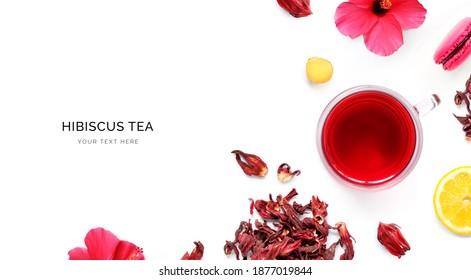 Kreatives Layout aus einer Tasse Hibiskus-Tee, Makronen und Zitrone auf weißem Hintergrund. Draufsicht.