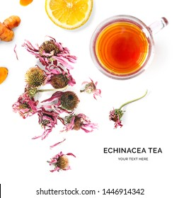 Creative layout made of cup of hot tea with echinacea and lemon on a white background. Top view.