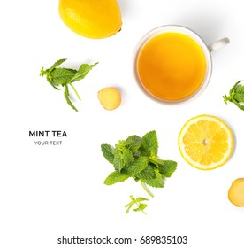 Creative layout made of cup of mint tea, lemon, ginger on a white background. Top view.