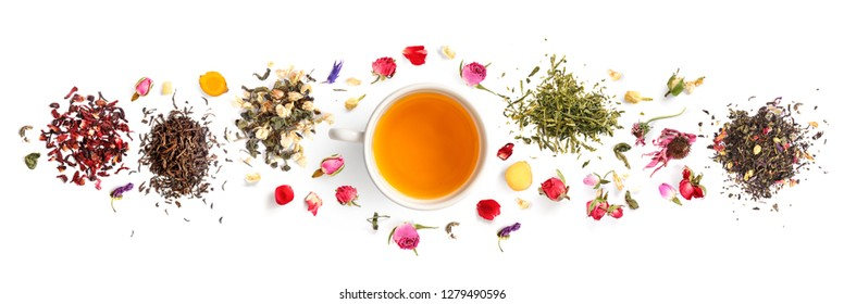 Creative layout made of cup of tea, green tea, black tea, fruit and herbal, tea, turmeric, ginger on white background.Flat lay. Food concept.