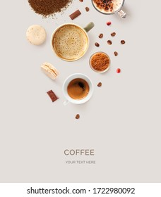 Creative layout made of cups of black coffee, cappuccino, expresso on beige background.Flat lay. Food concept.