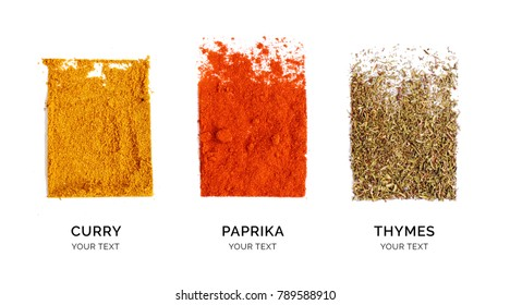 Creative layout made of curry, paprika and thyme. Flat lay. Food concept. Thyme, paprika and curry powder on the white background.