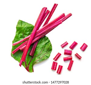Creative layout made of Fresh Rhubarb or Rheum with stalks, leaves  and pieces  vegetable isolated on white background. Top view. Flat lay